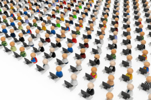 Crowd of small symbolic 3d figures behind office desks, isolated